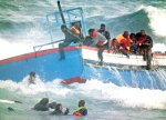boat-with-500-libya-refugees-runs-aground-in-italy-2011-05-08_l[1]
