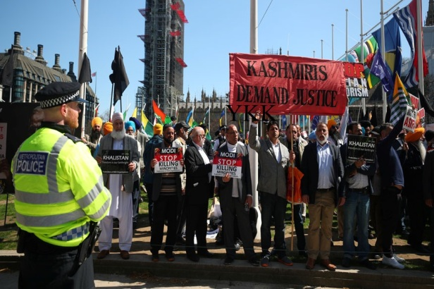 Demonstrators stage a protest against the visit by India's Prime Minister Narendra Modi in Parliament Square, London